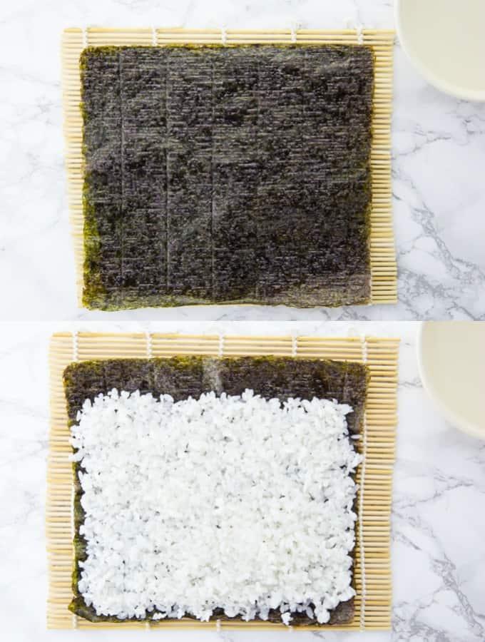Sushi Reis auf einem Noriblatt auf einer Bambusmatte